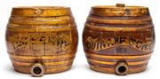 Sale 9054E - Lot 68 - A near pair of stoneware barrels with painted labels, one marked quinine tonic the other Raspberry? rubbed. Height 23cm.