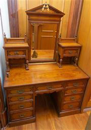 Sale 8649A - Lot 71 - A late Victorian oak and marquetry dressing table, the mirror of architectural form flanked by small shelves and drawers above a kne...