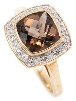 Sale 9145 - Lot 335 - A GOLD SMOKY QUARTZ AND DIAMOND RING; bezel set in 9ct gold with a cushion shape chequerboard cut quartz to surround of single cut d...