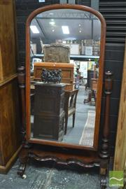 Sale 8317 - Lot 1035 - Victorian Mahogany Cheval Mirror, with arched mirror, turned supports & shaped base (veneer losses & repair to mirror)