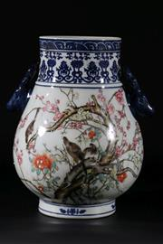 Sale 9015 - Lot 21 - A blue and white twin handled Chinese vase, decorated with butterlfies and birdsH: 29cm