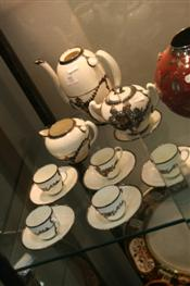 Sale 7876 - Lot 91 - English Ceramic Part Coffee Set with Metal Mounts