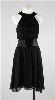Sale 8740F - Lot 17 - An Alex Perry black sleeveless halterneck cocktail dress with open back and fluted hem, with contrasting satin sash, approx size 6