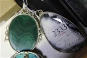 Sale 8134B - Lot 379 - TWO SILVER STONE SET PENDANTS; one set with malachite other with dendritic agate. Wt. 103.4g.