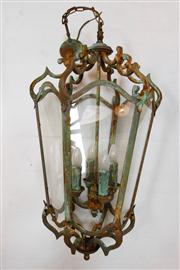 Sale 8272A - Lot 11 - A large vintage 4 light wrought iron lantern with 6 glass panels. Size without chain 76 x 46 cm