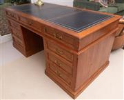 Sale 8550H - Lot 136 - A vintage pine double pedestal eight drawer desk, with a three panel gilt tooled leather top above three frieze drawers on a double...