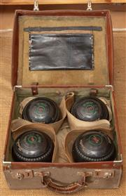 Sale 8984H - Lot 370 - A leather suitcase of bowls.