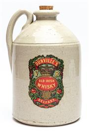 Sale 9054E - Lot 72 - A Victorian stoneware flagon bearing label for Dunvilles Irish Whisky, Belfast. Height 30cm