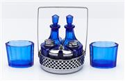 Sale 9080W - Lot 89 - A vintage blue glass bottle cruet and two liners.
