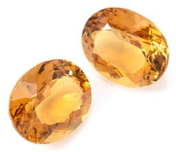 Sale 9145 - Lot 333 - A PAIR OF UNSET OVAL CUT GOLDEN BERYL; 2 total 6.84ct, sizes 10.99 x 8.94 x 5.88 and 11 x 9.02 x 5.92mm.