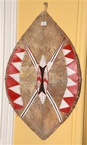 Sale 8080A - Lot 18 - An African painted vellum shield. 63cm height.