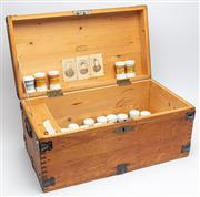Sale 9054E - Lot 73 - A travelling chemists pine chest with iron locks and handles containing a large quantity of french milk glass apothecary jarlets.
