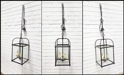 Sale 9126 - Lot 1061 - Set of Three Patinated Brass Hall Lanterns, of square form, each with three branches of lights, with chains (h:160 w:31 d:31cm)