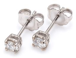 Sale 9124 - Lot 490 - A PAIR OF SOLITAIRE DIAMOND STUD EARRINGS; each bead claw set in 14ct white gold with a round brilliant cut diamond, 2 totalling app...