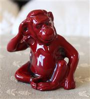 Sale 8250 - Lot 20 - A Royal Doulton Flambé Figure of a Monkey, c 1930 modelled seated , h 18.5cm repaired