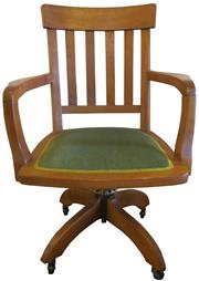 Sale 8258A - Lot 40 - Oak desk chair in Arts and Crafts style with upholstered seat, swivel and tilt on casters, RRP $750