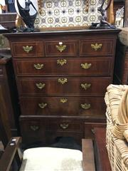 Sale 8740 - Lot 1084 - Early Georgian Style Walnut Chest on Chest, fitted with nine drawers and base with shaped apron