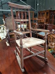Sale 8993 - Lot 1097 - Victorian Fruitwood Rocking Armchair, with two rows of spindles, rush seats & turned legs (H:106 W:53cm)