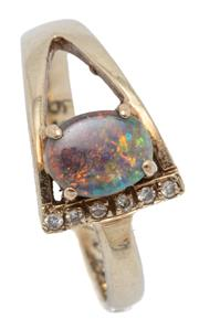 Sale 9046 - Lot 568 - A 10CT GOLD OPAL AND DIAMOND RING; modernist design centring a 7 x 5.5mm solid opal of mainly blue and green colours, one shoulder s...