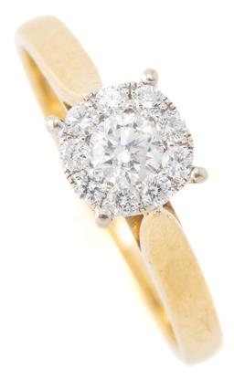 Sale 9149 - Lot 340 - AN 18CT GOLD DIAMOND CLUSTER RING; centring a round brilliant cut diamond of approx. 0.15ct (surface reaching fracture) to surround...