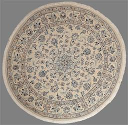Sale 9162 - Lot 1025 - Unusual Nain round wool carpet, with central medallion & peony arabesques, possibly silk inlays.  (Diameter: 200cm)