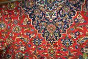 Sale 8460 - Lot 1009 - Vintage Persian Kashan Wool Carpet, with blue medallion & pendants on a red arabesque field, with signature panel