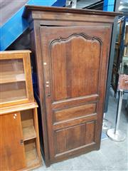 Sale 8728 - Lot 1007 - 19th Century French Elm Armoire, with shaped door enclosing shelves (key in office)