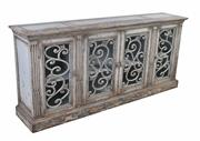 Sale 8912H - Lot 89 - A large sideboard featuring salvaged timber. Four doors with fleur de lis wrought iron in door fronts. Fluted end vertical panels. F...