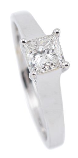 Sale 9124 - Lot 497 - AN 18CT WHITE GOLD SOLITAIRE DIAMOND RING; bead claw set with a princess cut diamond of 0.63ct, G - P1, size M 1/2, width 4.8mm, wt....