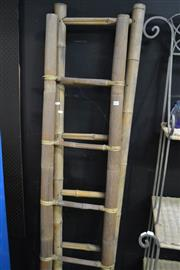 Sale 8093 - Lot 1021 - Pair of Bamboo ladders