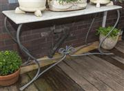 Sale 8575H - Lot 88 - A marble topped wrought iron outdoor table H: 76cm W: 150cm D: 50cm
