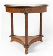 Sale 8620A - Lot 65 - An antique French Empire revival centre table c. 1900. The circular birds eye figured walnut top cross banded in tulip wood with dou...
