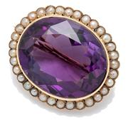 Sale 9066 - Lot 383 - AN ANTIQUE GOLD AMETHYST AND PEARL BROOCH; centring an oval cut fine purple amethyst of approx. 32.40ct to a surround of seed pearls...