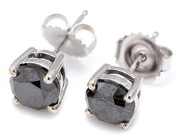 Sale 9124 - Lot 492 - A PAIR OF SOLITAIRE BLACK DIAMOND STUD EARRINGS; each bead claw set in 9ct white gold with a round brilliant cut treated black diamo...