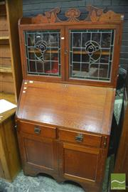 Sale 8326 - Lot 1734 - Timber Bureau Bookcase with Leadlight Panel Doors Above Two Drawers and Doors