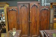 Sale 8359 - Lot 1047 - Victorian Mahogany Breakfront Wardrobe, with four carved panel doors, the centre raised doors enclosing drawers
