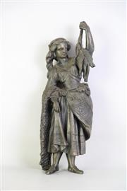 Sale 8923B - Lot 81 - A patinated spelter figure of a young girl in period costume holding aloft the days catch. Height 20cm