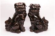 Sale 9015C - Lot 705 - A Pair of Large Brown Glazed Potted Foo Lions (H 52cm)