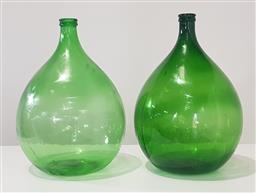 Sale 9188 - Lot 1719 - Pair of large green glass bottles (h:66cm)