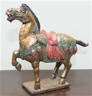 Sale 8368A - Lot 60 - A carved and painted timber marching Oriental horse, H 33cm