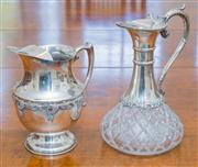 Sale 8402H - Lot 54 - A heavy crystal and EP claret jug, together with a crusader EP water jug with vine decoration. Taller 28cm.