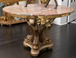 Sale 9248H - Lot 49 - A marble top circular entrance table with dolphin tripod supports, diameter 122cm x height 79cm