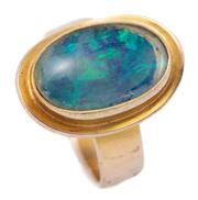 Sale 9083 - Lot 523 - A 10CT GOLD OPAL RING; set with an opal triplet (foggy), size O1/2, top 19 x 13mm, wt. 5.62g.