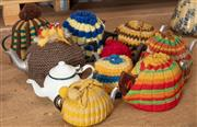 Sale 8984H - Lot 378 - Ten small metal teapots with cosies