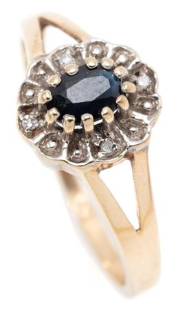 Sale 9145 - Lot 379 - A 9CT GOLD SAPPHIRE AND DIAMOND CLUSTER RING; multi claw set with a dark blue oval sapphire surrounded by 4 single cut diamonds, siz...
