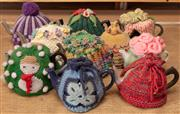 Sale 8984H - Lot 379 - Ten small metal teapots with cosies