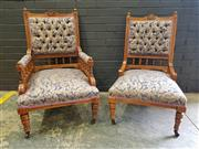 Sale 8993 - Lot 1012 - Pair of Edwardian Walnut Gentlemans & Ladys Chairs, upholstered in a blue & cream floral fabric, with spindle gallery & turned leg...