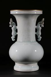 Sale 9015 - Lot 85 - A tall Chinese celadon twin handled vase H:35cm