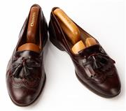 Sale 9080F - Lot 25 - A PAIR OF HANDMADE CHURCHs LOAFERS; in chocolate leather, size 8.5W (shoe last included)