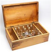 Sale 9054E - Lot 81 - A pine hinged specimen chest containing a quantity of glass bottles, some with labels, mainly Metzer.